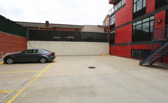 Outdoor lot parking on Rd in Queens